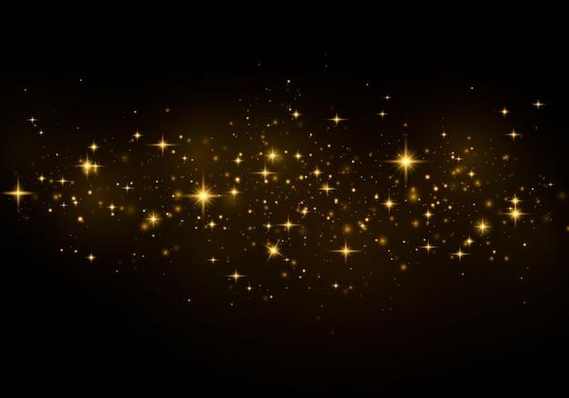 Abstrakter stilvoller lichteffekt auf einem schwarzen transparenten hintergrund. gelber staub, gelbe funken und goldene sterne leuchten mit besonderem licht.