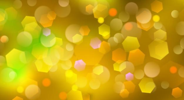 Abstrakter unscharfer hintergrund mit bokeh-effekt in gelben farben
