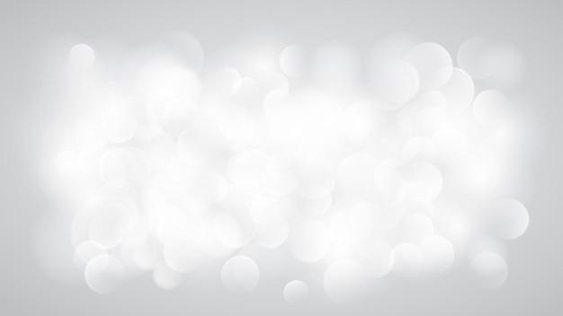 Abstrakter unscharfer hintergrund mit bokeh-effekt in weißen farben
