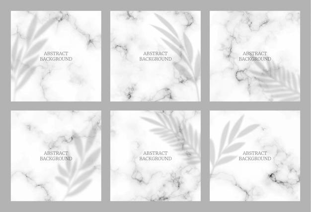 Abstraktes design für social media insta feed post. marmorstruktur mit tropischer blattschattenauflage.