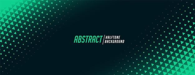 Abstraktes dreieck-halbton-banner in grüner farbe