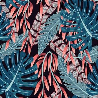 Abstraktes helles nahtloses muster mit bunten tropischen blättern und anlagen auf schwarzem