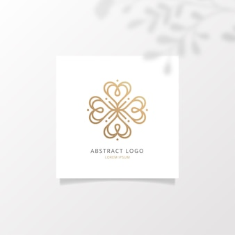 Abstraktes logo auf quadratischem papiermodell mit realistischen schatten überlagert blatt
