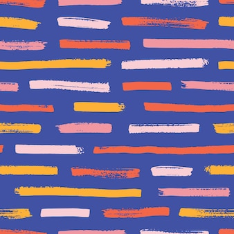 Abstraktes nahtloses muster mit bunten farbspuren auf blauem hintergrund