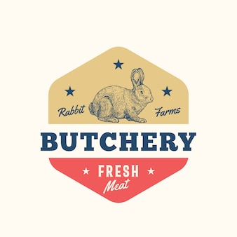 Abstraktes zeichen, symbol oder logo-schablone des frischen fleisches der kaninchenfarmen. hand gezeichnete kaninchen-sillhouette mit retro-typografie. vintage emblem.