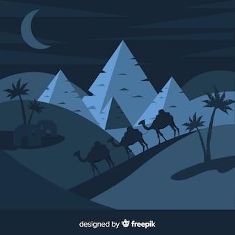 Ägypten-landschaftshintergrund mit kamelen und piramiden