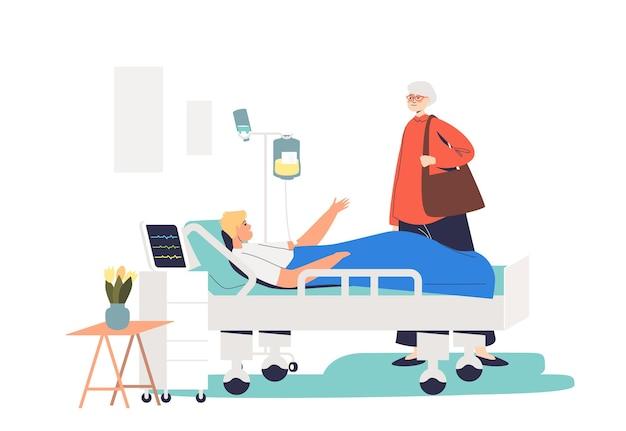 Ältere dame, die jungen mann im krankenhaus besucht