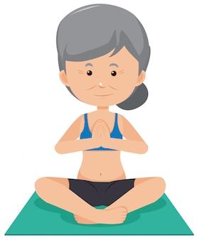Ältere dame, die yoga tut