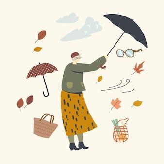 Ältere frau, die gebrochenen regenschirm hält, der vor hurrikan schützt