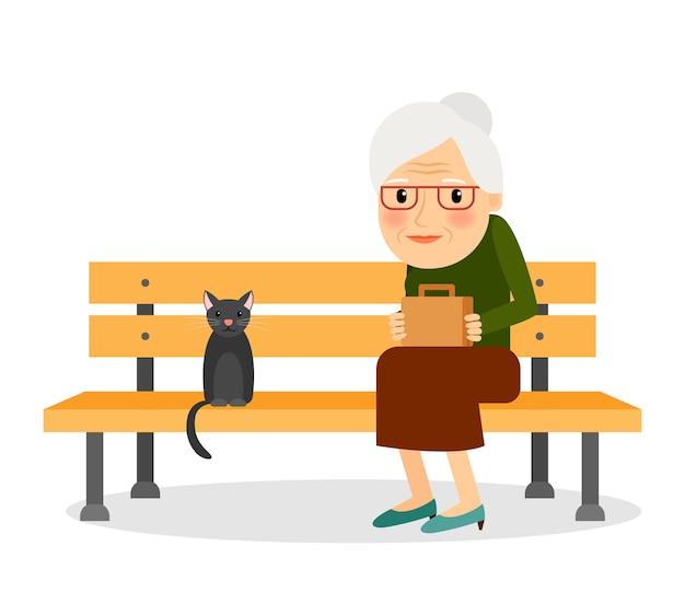 Ältere frau und katze, die auf parkbank sitzt
