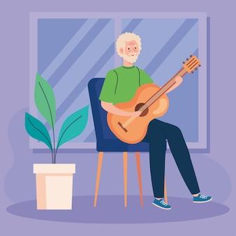 Älterer mann, der gitarre im haus spielt.