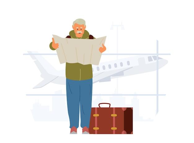 Älterer mann mit koffer hält karte im flughafen