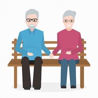 Älterer mann und frau, die auf bank sitzen.