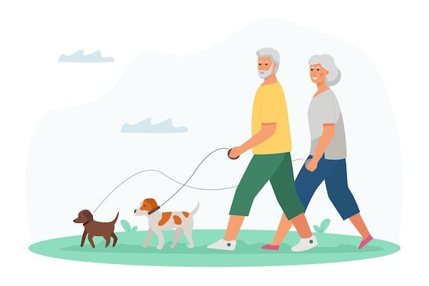 Älterer mann und frau, die mit hunden gehen. aktiver lebensstil und freizeitaktivitäten für senioren.