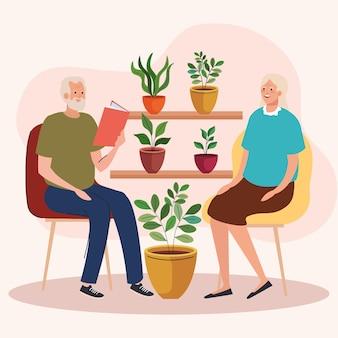 Älteres altes ehepaar sitzt auf dem stuhl im garten