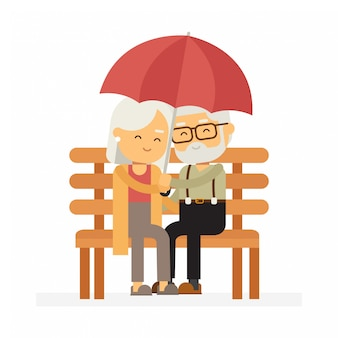 Älteres ehepaar sitzt mit regenschirm