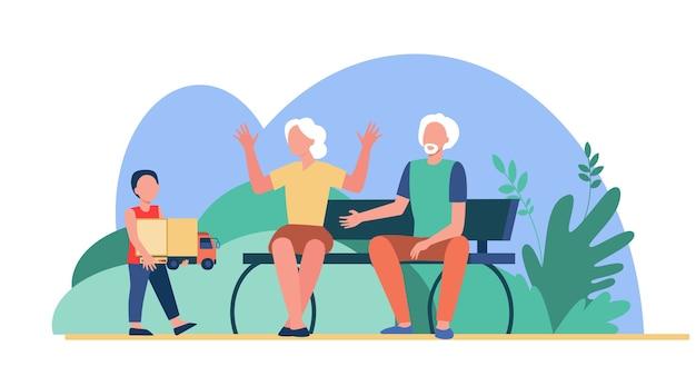 Älteres paar, das enkel im freien kümmert. junge, der spielzeug zur flachen illustration der großeltern trägt.
