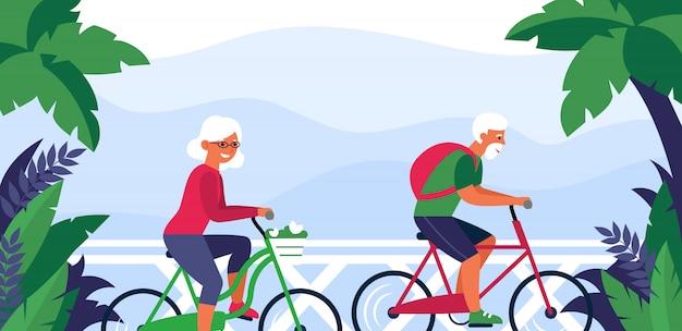 Älteres paar, das fahrrad fährt