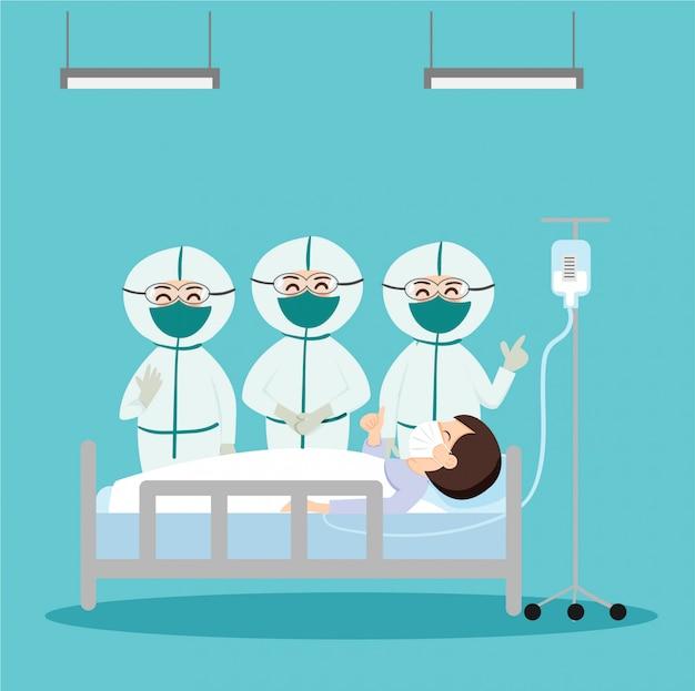 Ärzte im covid-19-schutzanzug behandeln einen patienten im krankenhaus