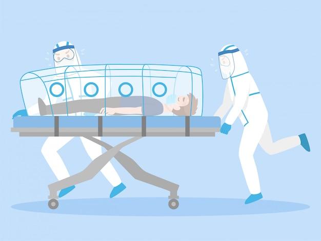Ärzte im persönlichen schutzanzug bewegen sie ernsthaft patienten, die auf einer bettbahre liegen. unterdruck für die quarantäne des infizierten patienten-coronavirus