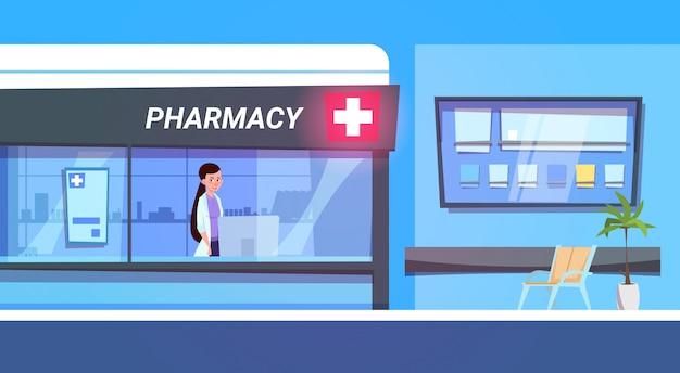 Ärztin in pharmacy store im modernen krankenhaus-drogerie-shop