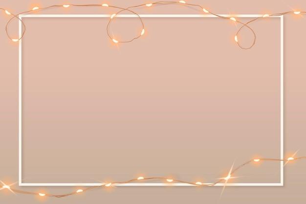 Ästhetischer rahmenvektor mit leuchtenden verdrahteten lichtern auf rosafarbener grafik