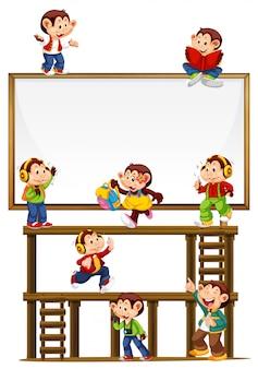 Affen, die auf einem anschlagtafelzeichen lokalisiert spielen