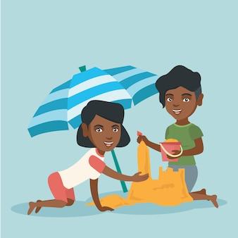 Afrikanische freunde bauen eine sandburg am strand