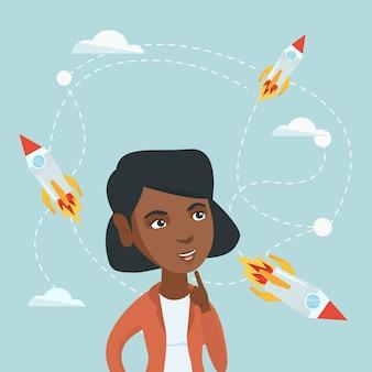 Afrikanische geschäftsfrau, die fliegenraketen betrachtet.