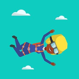 Afrikanischer fallschirmspringer, der mit fallschirm springt.