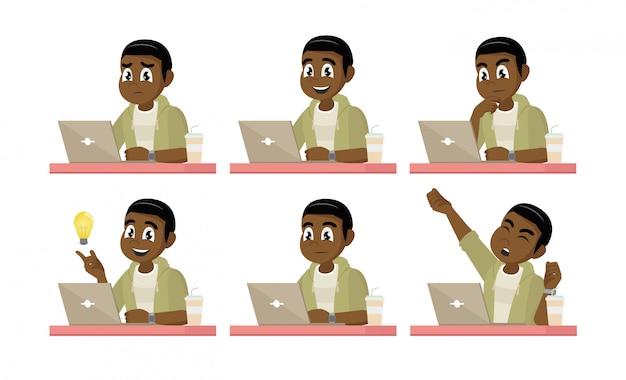 Afrikanischer geschäftsmann am desktop mit einem laptop