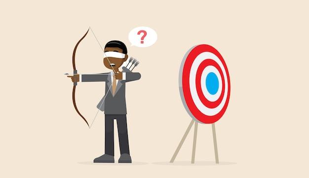 Afrikanischer geschäftsmann mit verbundenen augen, der pfeil schießt.