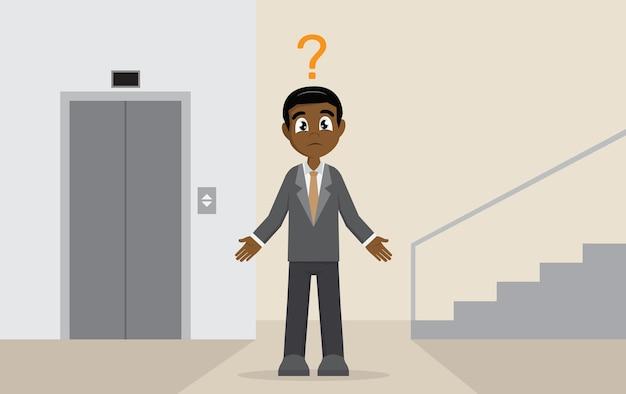 Afrikanischer geschäftsmann wählen zwischen dem aufzug oder der treppe.
