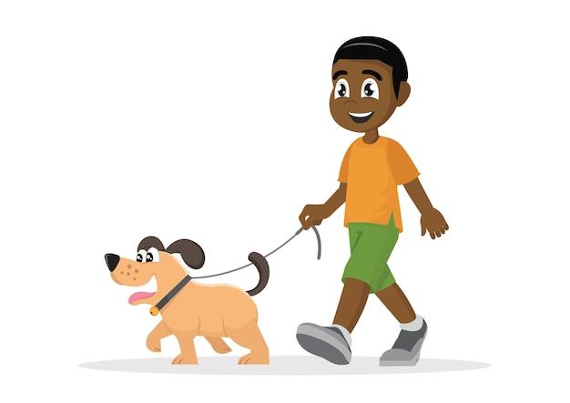 Afrikanischer junge, der mit hund geht.