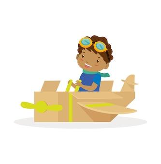 Afrikanischer junge mit dem flugzeugspielzeug