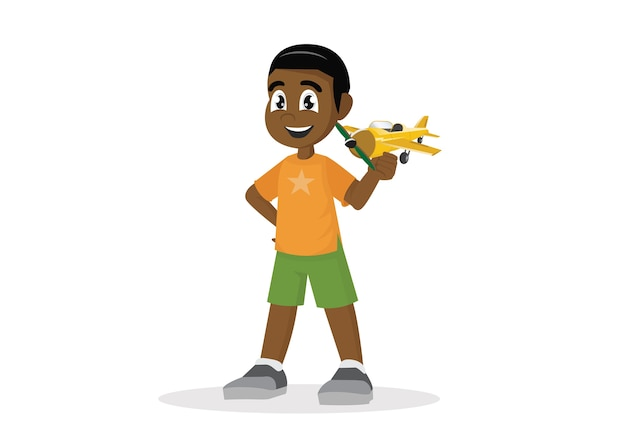 Afrikanischer junge mit spielzeugflugzeug.