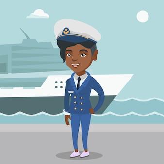 Afrikanischer schiffskapitän in uniform im hafen.