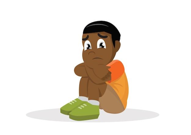 Afrikanischer trauriger junge.