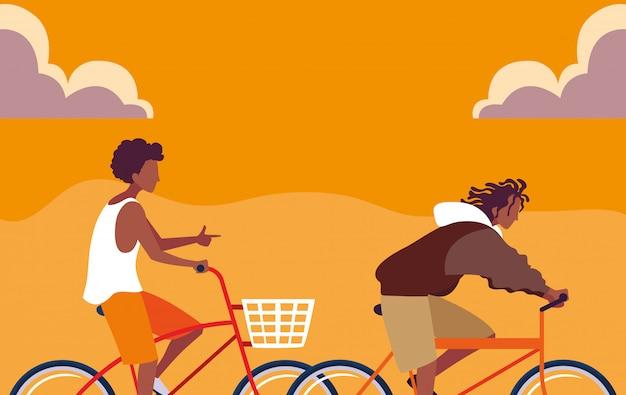 Afrikanisches reitfahrrad der jungen männer mit himmelorange