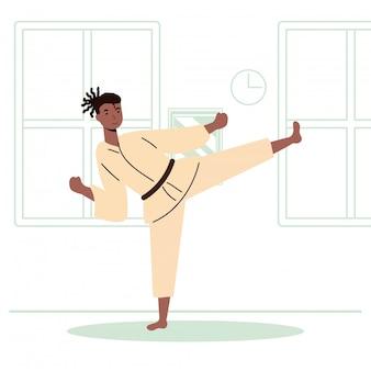 Afro-mann, der karate-sportaktivität im haus übt
