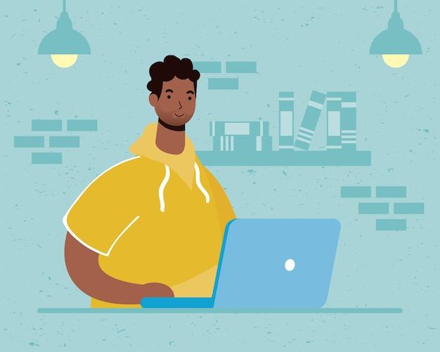 Afro-mann mit laptop-computer im haus