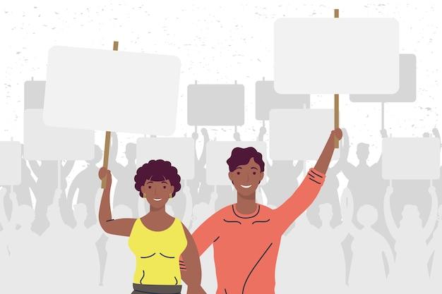 Afro-paar protestiert gegen wahlkampffiguren