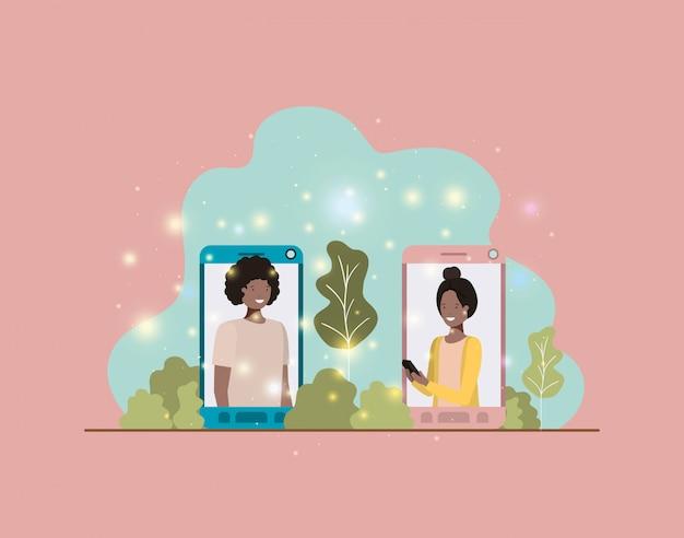 Afro-paare im smartphone auf landschaft