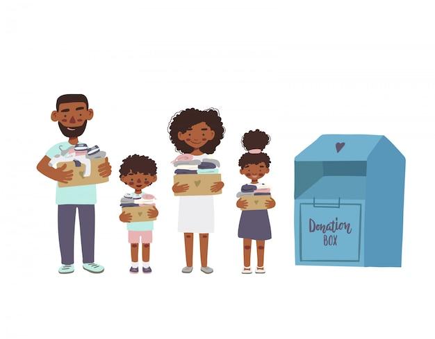 Afroamerikanerfamilie oder freiwillige, die pappkartons mit kleidung für spende oder recycling halten.