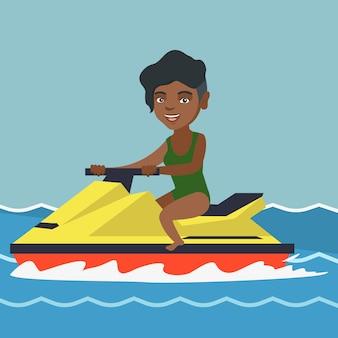 Afroamerikanerfrau, die einen wasserscooter reitet.