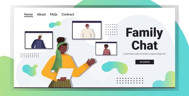 Afroamerikanerfrau, die virtuelles treffen mit familienmitgliedern in webbrowser-windows-videoanruf-online-kommunikationskopieraumporträt hat