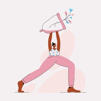 Afroamerikanische frau steht in yoga-pose und hält menstruationscu