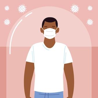 Afroamerikanischer mann mit medizinischer maske während coronavirus covid 19