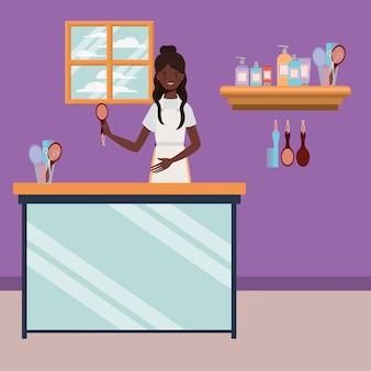 Afrofrauenstilist, der an der salonarbeitsplatzszene arbeitet