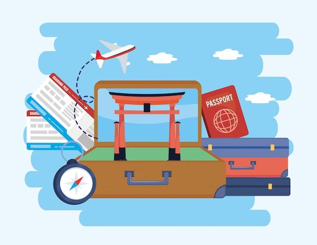 Aktentasche mit tokio-skulptur und tickets mit reisepass
